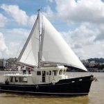 Diesel Duck sedan open sails starboard