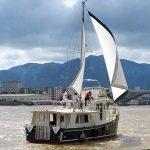 Diesel Duck sedan after starboard quarter sails