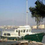 Diesel Duck sedan docked