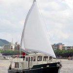 Diesel Duck sedan open sails
