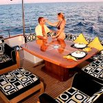 82 euro couple sitting on aft deck